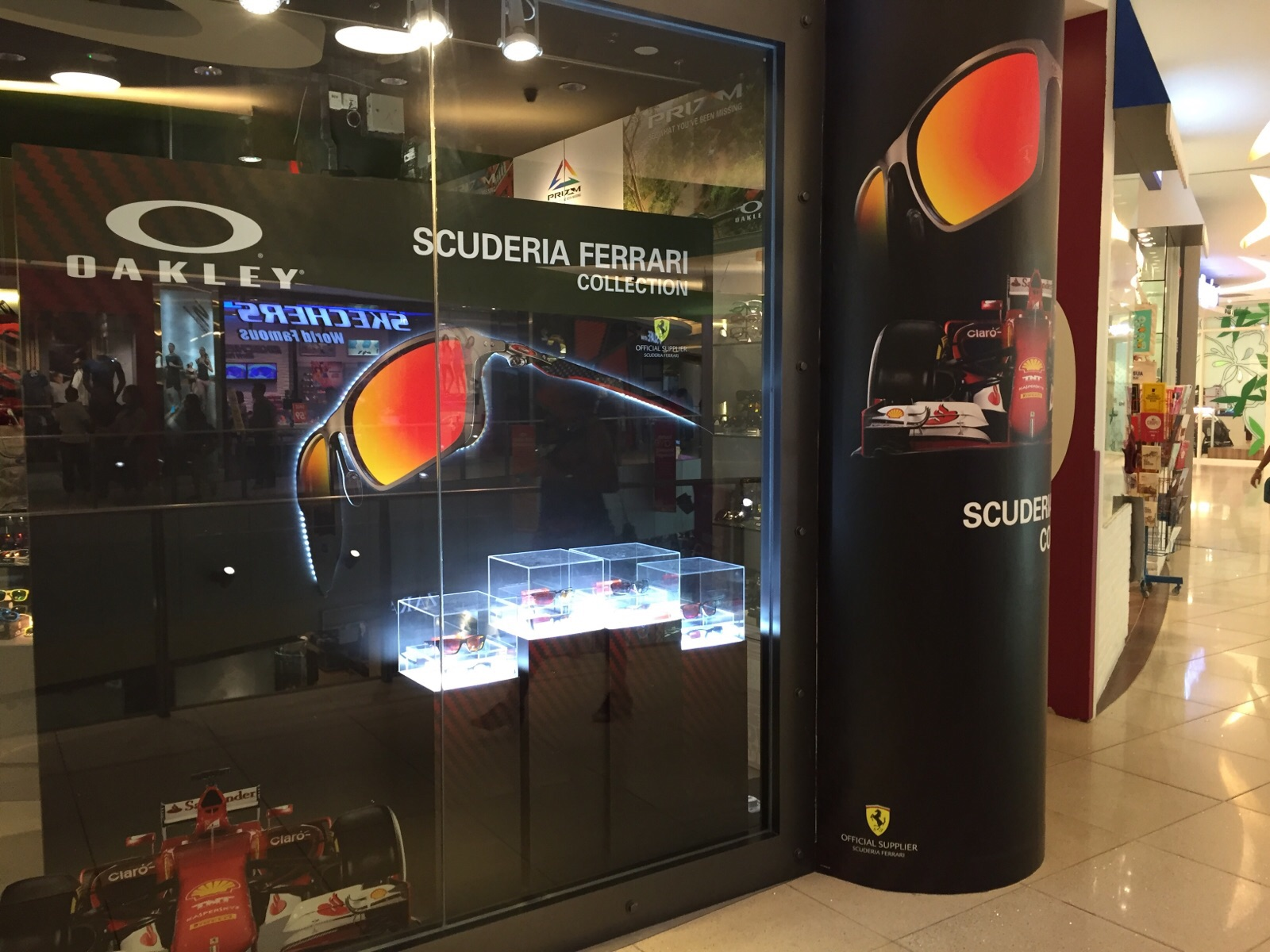 <p>A small window display for Oakley / Ferrari Scuderia collection. Just in time for the F1 racing season here in Singapore.</p>